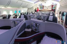 through the lens onboard qatar airways boeing 787 dreamliner business class cabin on qatar s 787