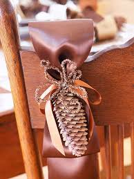 pinecone and ribbon thanksgiving chair decorations better homes
