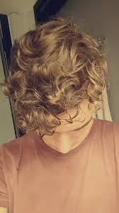why is my hair curly in front and straight in back my hair is wavy curly in the front but more straight towards the