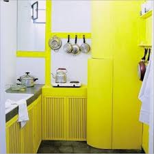 small kitchen with stainless steel appliances and yellow cabinets