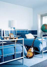 two blue beds blue rug guitar in modern shared kids room dweef