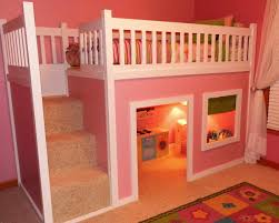 bedroom bunk beds with stairs and desk and slide tv above
