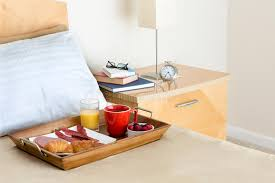 breakfast in bed table breakfast in bed tray on bed next to bedside table stock image