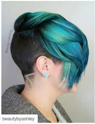turquoise teal green dyed hair with shaved sides and back dyed