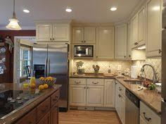cream kitchen cabinets with cocoa glaze nvg granite white subway
