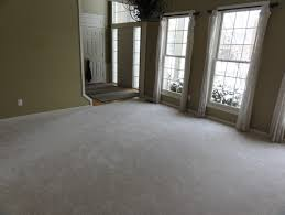 wood floor or wood border with carpet in middle