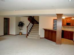 bright basement kitchen idea near staircase with white interior