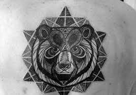 black and white geometric bear head and mandala tattoo