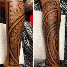 polynesian forearm tattoo