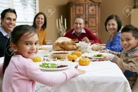 multi generation family celebrating thanksgiving stock photo