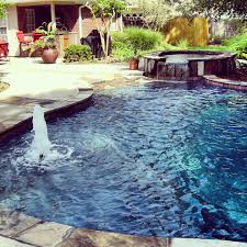 backyard oasis by preferred pools with boulder stone coping and