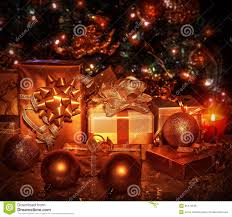 christmas presents under a tree christmas lights decoration