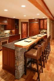 red oak wood light grey yardley door island in the kitchen