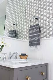 my secret weapon for wallpapering your bathroom driven by decor great post on using wallpaper in bathrooms with tips for how to make it work