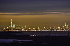 brilliant nyc skyline at night with sandy hook in foreground