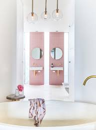 a gorgeous pink tiled bathroom with gold hardware pink tile