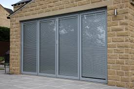 light grey aluminium bi fold doors with integral blinds
