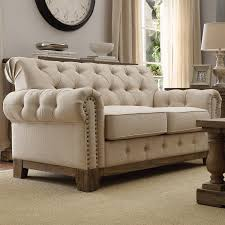 furniture gray tufted loveseat with smooth cushions and rustic