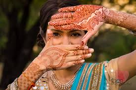 henna tattoo indian bride indian bride looking at her hands with
