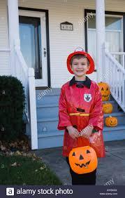 fireman halloween costumes boy dressed in fireman halloween costume stock photo royalty free