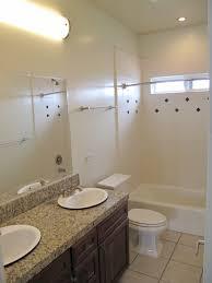 hall bathroom ideas hall bathroom with dual sinks and granite tile counters 1875