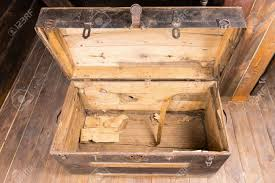 wooden trunk empty old vintage wooden chest with the lid open standing on