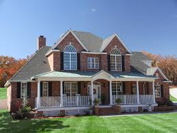 two story house with balcony houses front porches brick house