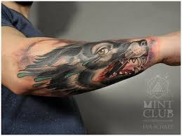 coloured wolf with a bloody forearm tattoos