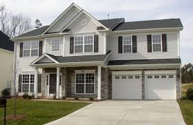 Home Exterior Design With Stone Brown Exterior Paint Colors With Stone That Has White Garage Door