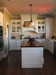 White Kitchens With Dark Floors by I Love This White With Dark Floor And Dark Butcher Block Counter
