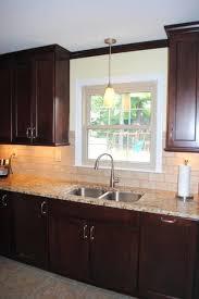 kohler simplice kitchen faucet maple cranberry with black glaze cabinets kohler simplice