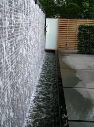 15 backyard waterfalls for soothing and peaceful modern backyard