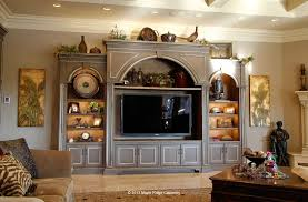 furniture style entertainment center houses a large tv and