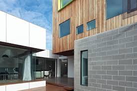 home design building blocks besser block black framed windows timber cladding 6 the parade