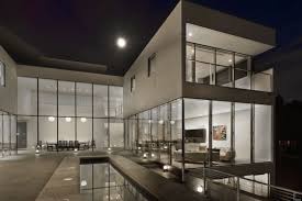 interior modern mansion with sofa and large picture windows for