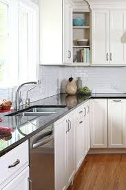 white kitchen cabinets with antique brown granite antique brown granite countertop white cabinet subway