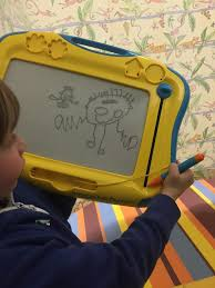 boy 7 used his etch a sketch to draw a black spot pinpointing