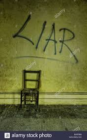 The Chair Is Against The Wall An Empty Chair Sits Against A Wall With Graffiti Written On The
