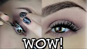 applying false fake eyelashes under your real lashes does it