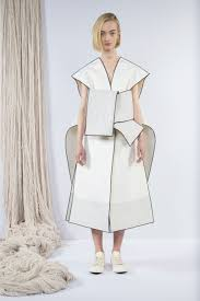 sculptural fashion clean dress with graphic outline detail
