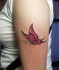 pink flying butterfly on left bicep