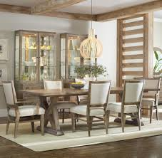 7 piece dining set with geo trestle table and stol upholstered