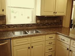 Baltic Brown Granite Countertops With Light Tan Backsplash by Tan Brown Granite White Cabinets Giallo Vicenza Granite