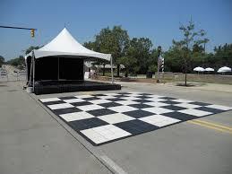 white floor rental 20 x 20 festival frame tent with black white floor