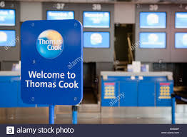check in desk sign sign welcome to thomas cook at the airport check in desks stock