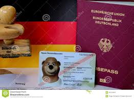 german passport application form with passports stock photo