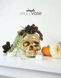 gilded skull vase