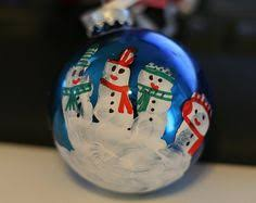 handprint snowmen ornament and reindeer thumb print ornament