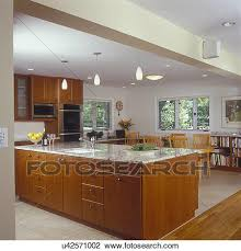 stock photo of kitchens view towards island counter and family