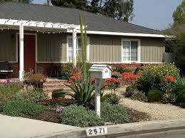 ranch style house with beautiful drought tolerant garden drought